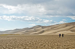 Women Walking in Sand Royalty Free Stock Images