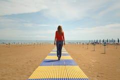Women walking on sandy beach royalty free stock photography