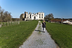 Women walking towards Bidache Castle ruins. Ruins of Bidache castle, called also Chateau des ducs de Gramont, situated in Bidach village in Basse Navarre of royalty free stock images