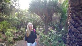 Women walking in tropical park. Young women walking in tropical park stock video footage