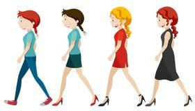 Women walking on white background Royalty Free Stock Images