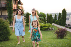 Women Walking in Yard Royalty Free Stock Image
