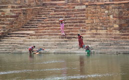 Women washing clothes near by a pond, India Royalty Free Stock Photo