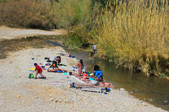 Women washing clothes on the river royalty free stock images