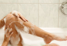 Women washing her legs Royalty Free Stock Photos