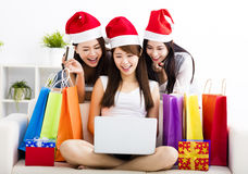 Women watching laptop with christmas shopping concept Stock Photos