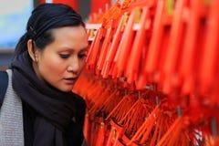 Women watching wishing wood in Japan Stock Photos