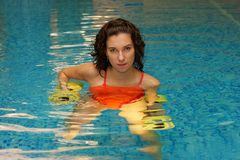 Women in water with dumbbels Stock Images