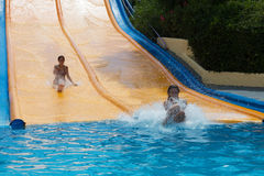 Women on water slide at Water Park Stock Photography