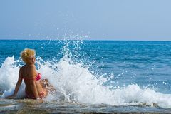 Women and waves Stock Image