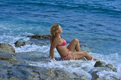 Women and waves Royalty Free Stock Photography