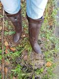 Women wear boots, She is a farmer. Women wear boots, trample mud and water for farming, dirty, wet, at worked Stock Photos