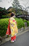 Women wear Japanese kimono on street. Kyoto, Japan - Nov 20, 2016. Japanese women wearing traditional dress Kimono on the historic street in downtown of Kyoto royalty free stock photography