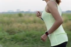 Women wear smart hand watch running Royalty Free Stock Photos