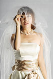 The women wear a wedding dress Royalty Free Stock Images
