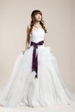 The women wear a wedding dress Royalty Free Stock Photos