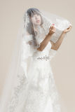The women wear a wedding dress Royalty Free Stock Photography