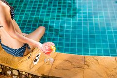 Woman in pool villa Royalty Free Stock Photography
