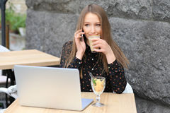 Women is wearing black shirt in the cafe stock photo