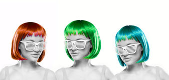 Women wearing blinder shutter sunglasses. Trio of beautiful woman with bright colorful red, green and blue hair wearing blinder shutter shades or louvered Stock Image