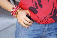 Women wearing bracelet and jewelry with jeans. Stock Image