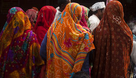 Women wearing colourful sarees. And standing together in a local festival in India Stock Images