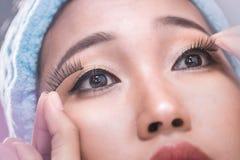 Women are wearing false eyelashes royalty free stock image