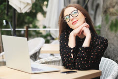 Women is wearing glasses and black shirt in the cafe Royalty Free Stock Photography
