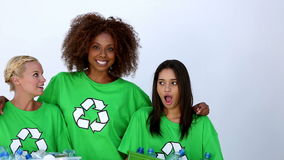 Women wearing green ecologic tshirt. And talking together stock video footage