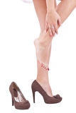 Women wearing high heels brown shoes. Massaging tired legs Royalty Free Stock Images