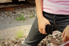 Women wearing jeans holding a cell phone. Royalty Free Stock Photography