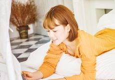 Women wearing orange shirts are listening to music and are happy. royalty free stock photos