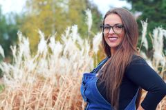 Women wearing overalls wheat field countryside farming agriculture outdoor blue jeans glasses joyful worker Stock Photos