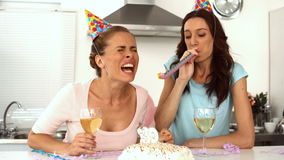 Women wearing party hats celebrating birthday together Stock Image