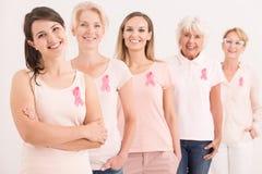 Women wearing pink shirts Stock Images