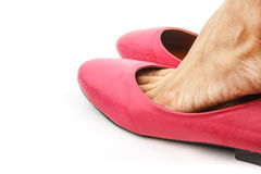 Women is wearing a pink shoe Stock Images