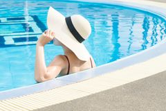 Women wearing straw hats and relax stock photos
