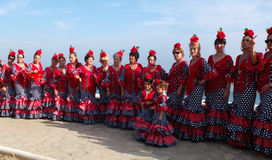 Women wearing traditional Andalusian dresses. Royalty Free Stock Image