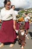 Women wearing in traditional costumes at Madeira Wine Festival in Estreito de Camara de Lobos, Madeira, Portugal. Stock Image
