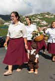 Women wearing in traditional costumes at Madeira Wine Festival in Estreito de Camara de Lobos, Madeira,. Portugal. The Madeira Wine Festival honors the grape Royalty Free Stock Image