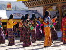 Women wearing traditional dresses at a festival Stock Images