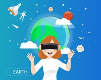 Women wearing virtual reality glasses looking the earth in unive Stock Image