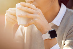 Women wears smart watch and drinking Royalty Free Stock Photos