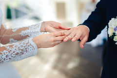 A women wears a wedding ring on the finger of a man on wedding ceremony Royalty Free Stock Images