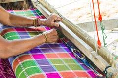 Women weave Stock Image