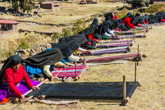 Women weaving in the peruvian Andes at Puno Peru. Puno, Peru - July 25, 2013: women weaving in the peruvian Andes at Taquile Island on Puno Peru at july 25th Stock Photography