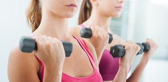 Women weightlifting at the gym Royalty Free Stock Photos