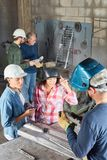 Women in welding lessong during apprenticeship. In metallurgy workshop royalty free stock photo