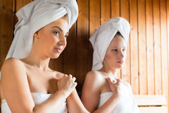 Women in wellness spa enjoying sauna infusion Stock Images