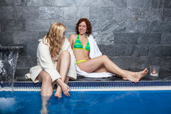 Women in wellness and spa swimming pool Stock Photo